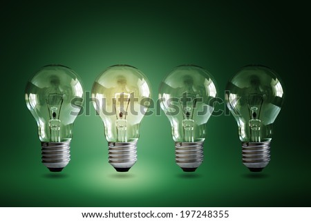 Illuminated light bulb in a row of dim ones concept for creativity, innovation and solution