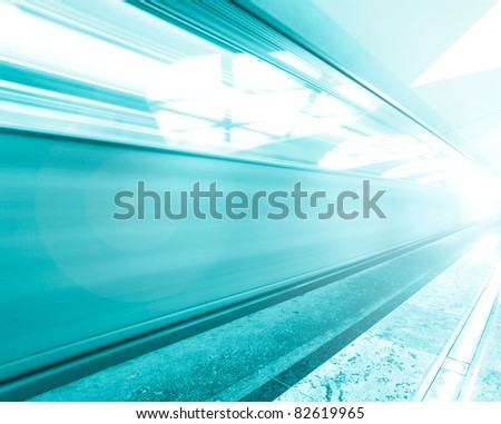 illuminated metro station with train motion - stock photo