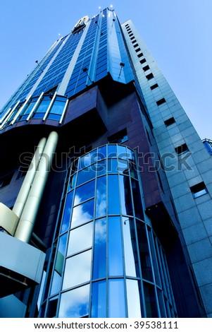 illuminated modern building skyscraper in the evening - stock photo