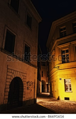 illuminated mysterious narrow alley at night in Prague - stock photo