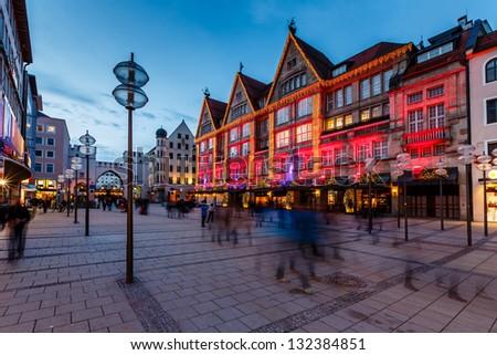 Illuminated Neuhauser Street and Karlsplatz Gate in Munich at the Evening, Germany - stock photo