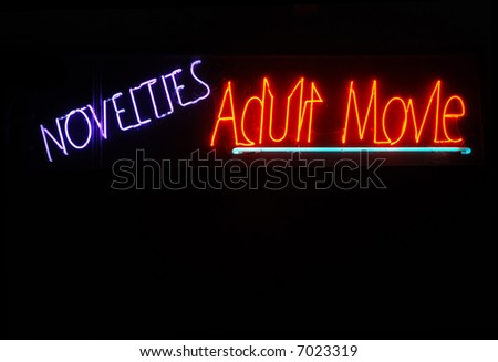 Illuminated novelties and adult movie neon sign - stock photo