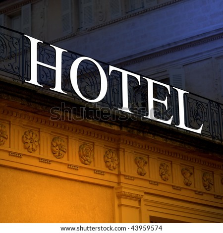 Illuminated old hotel sign - stock photo