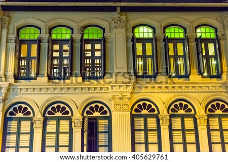 illuminated old house in Singapore, night time - stock photo