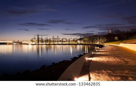 Illuminated path along the waters of Lake Burley Griffin in Canberra, Australian Capitol Territory. Australia. - stock photo