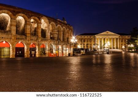 Illuminated Piazza Bra and Ancient Amphitheater in Verona, Veneto, Italy - stock photo
