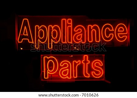 Illuminated red appliance parts neon sign