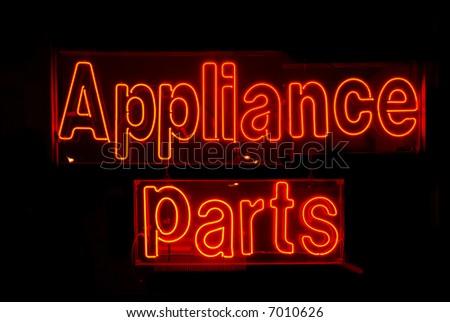 Illuminated red appliance parts neon sign - stock photo