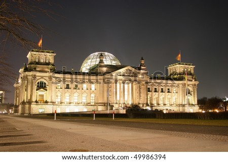 Illuminated Reichstag building in Berlin, Germany - stock photo