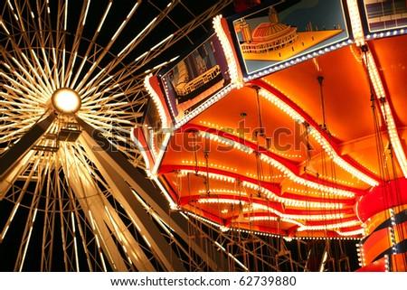 Illuminated rides at Navy Pier, Chicago - stock photo