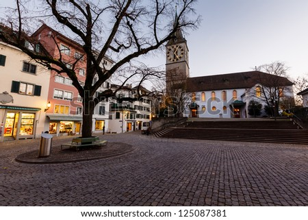 Illuminated Saint Peter Church in the Evening, Zurich, Switzerland - stock photo