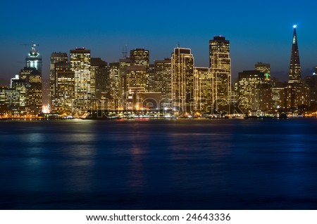 Illuminated San Francisco downtown at dusk (shot from Treasure Island). This illumination is on only for Christmas and New Year (~1.5 months per year). Copyspace on top and bottom - stock photo