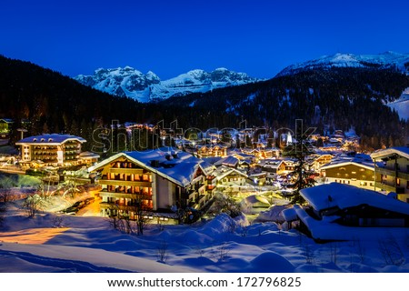 Illuminated Ski Resort of Madonna di Campiglio in the Morning, Italian Alps, Italy - stock photo