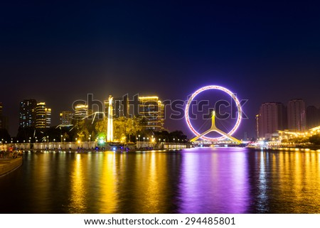 Illuminated skyline and cityscape at riverbank