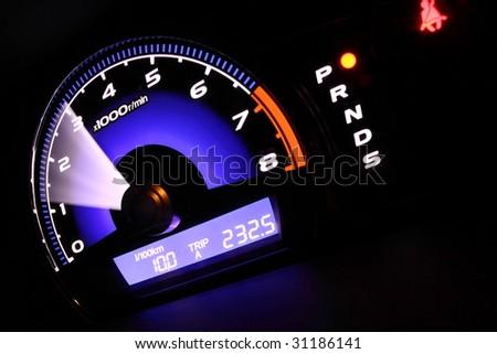 illuminated speedometer - stock photo