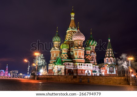 Illuminated St. Basil Cathedral at night in Red Square in Moscow, Russia. - stock photo