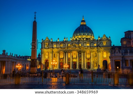 Illuminated St. Peters Basilica in Vatican City at night. Most famous square empty of people in the area, clear blue sky - stock photo