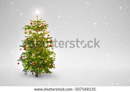 illuminated star on a christmas tree with snow falling
