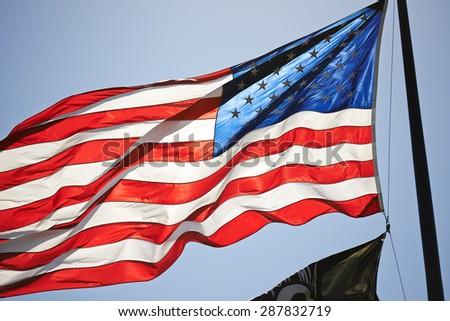 Illuminated Star Spangled Banner on Blue Sky - stock photo