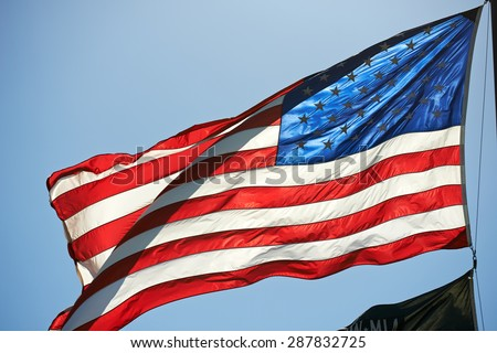 Illuminated Star Spangled Banner on Blue Sky - stock photo