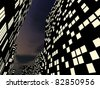 Illuminated streets of a city-center at night - stock photo