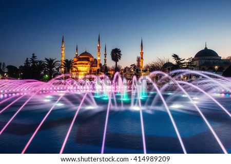 Illuminated Sultan Ahmed Mosque (Blue Mosque) before sunrise, Istanbul, Turkey - stock photo