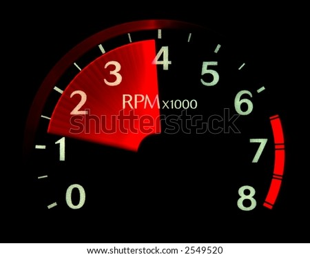 Illuminated tachometer revving up. - stock photo