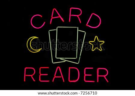 Illuminated tarot card reader neon sign on black - stock photo