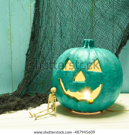 Illuminated teal Jack O' Lantern indicates allergy safe, non food treats for trick and treaters on Halloween night.