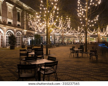 illuminated terrace around christmas time in amsterdam, netherlands - stock photo