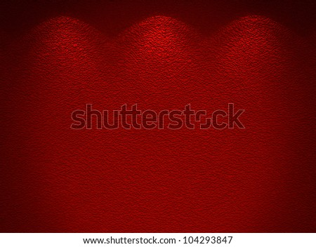 Illuminated texture of the red wall