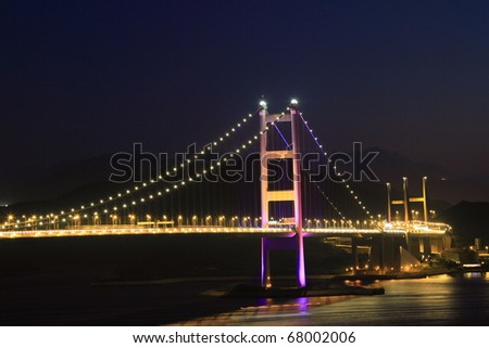 illuminated Tsing Ma Bridge, landmark bridge in Hong Kong at night