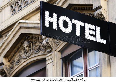 Illuminated urban hotel sign