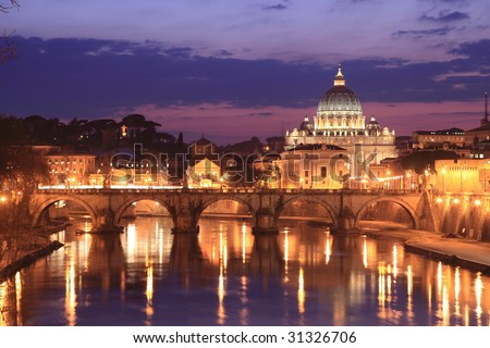 Illuminated Vatican viewed from Rome, with reflections in the water - stock photo