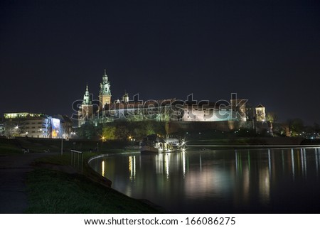 Illuminated Wawel castle in Krakow, Central Europe
