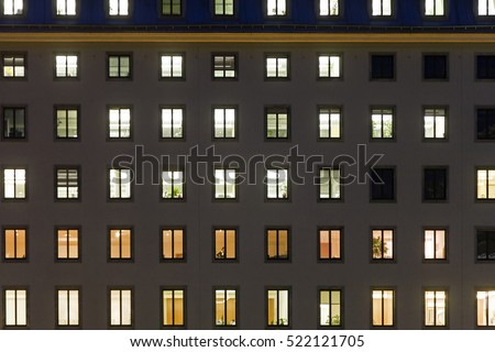 illuminated windows in a facade of a goverment building in Vienna, first district