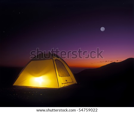 Illuminated Yellow Camping Tent At Night