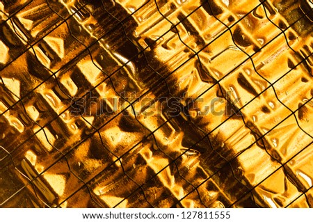 Illuminating golden yellow safety glass pattern - stock photo