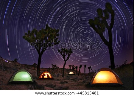 Illuminous Light Painted Landscape of Camping and Stars - stock photo