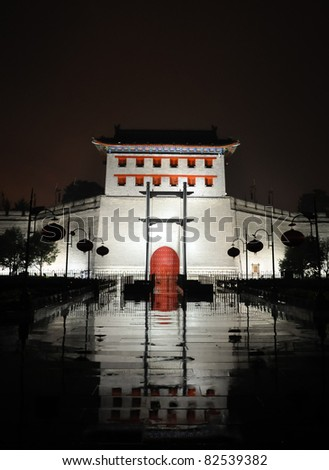 illumniated xian city wall west gate at a rainy night