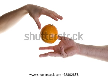Illusion with two hands and orange fruit - stock photo