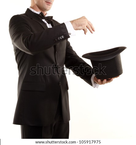 Illusionist magician is doing magic with top hat - stock photo