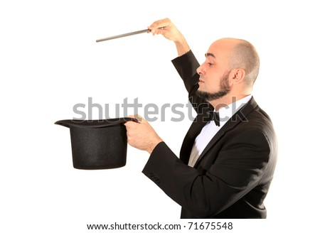 Illusionist magician with magic wand and top hat - stock photo