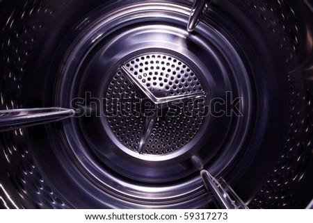 Illusory space inside washing/drying machine - stock photo