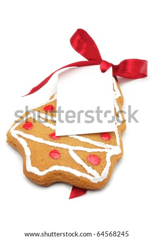Illustrated Christmas cookies - a Christmas tree. Decorated cookies as a gift. A red ribbon tied white cardboard card.Isolated on a white background. - stock photo