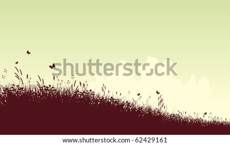 Illustrated silhouette of a grassy meadow and clouds with copy space - stock photo