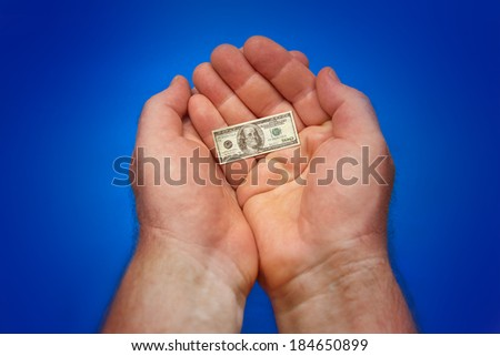 Illustration for inflation - hands holding last small banknote of US dollar, blue background - stock photo