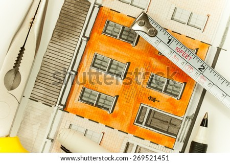 Illustration graphic material with orange shared twin elevation facade fragment with brick wall texture tiling shot with writing tools and measure tape, symbolizing custom approach to building design - stock photo