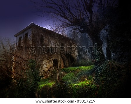 illustration of a dark haunted old house under moonlight - stock photo