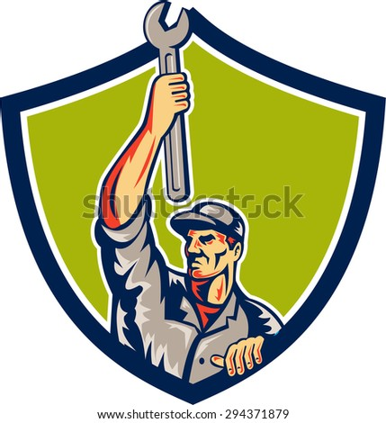 Illustration of a mechanic lifting raising up spanner wrench looking to the side viewed from front set inside shield crest on isolated background done in retro style.